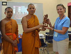 Stacy receiving gift from Venerable Sovechea
